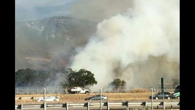 Brush fire closes lanes on I-15
