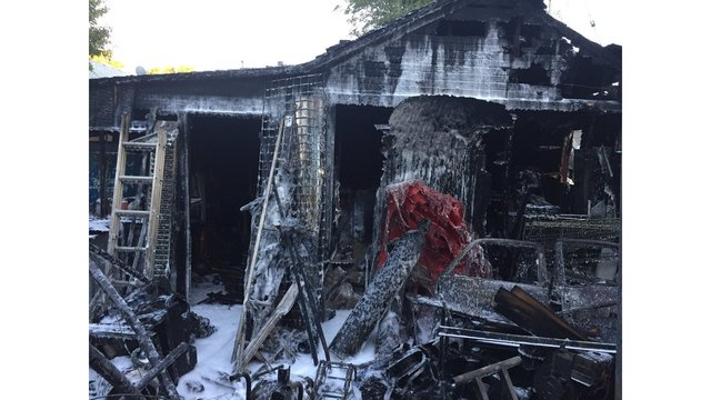 Two-alarm fire destroys shed and trailer, damages home