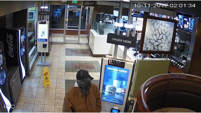 Armed robbery suspect loiters 20 minutes before committing act