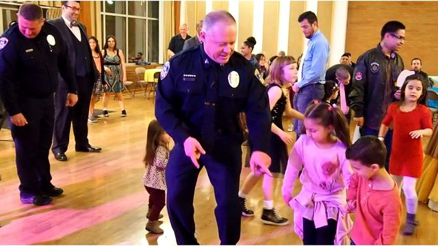 cops and firefighters fill in at daddy daughter dance in south salt lake